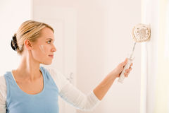 Home improvement - handywoman painting wall Royalty Free Stock Photography