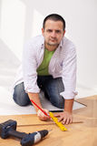 Home improvement - laying laminate flooring Royalty Free Stock Images