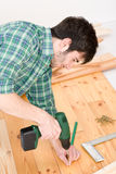 Home improvement - man installing wooden floor Royalty Free Stock Photos