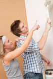 Home improvement: Man painting wall Royalty Free Stock Photo