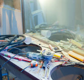 Home improvement  messy clutter with dusted tools Stock Photos