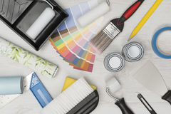 Home Improvement Painting Tools on White Wooden Surface Overhead Royalty Free Stock Images