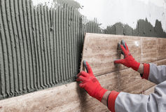 Home improvement, renovation - construction worker tiler is tili Stock Image