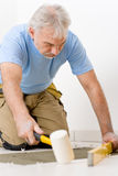 Home improvement, renovation - man laying tile Stock Photography