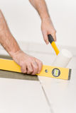 Home improvement, renovation - man laying tile Royalty Free Stock Photography