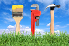 Home Improvement Tools Paintbrush, Pipe Wrench. Household Home Improvement Tools Paintbrush, Pipe Wrench and Hammer Royalty Free Stock Photography