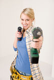 Home improvement - woman with battery screwdriver. Home improvement - woman with battery cordless screwdriver Royalty Free Stock Images