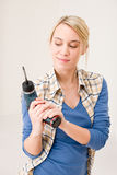 Home improvement - woman with battery screwdriver Stock Photo