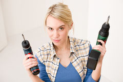 Home improvement - woman with battery screwdriver Royalty Free Stock Photography