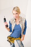 Home improvement - woman with battery screwdriver Royalty Free Stock Photo