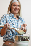 Home improvement: Woman holding can and brush Royalty Free Stock Photo