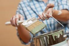 Home improvement: Woman holding paint brush Stock Photos