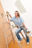 Home improvement: Woman with paint and brush Stock Photo