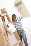 Home improvement: Woman with paint roller Royalty Free Stock Image