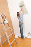 Home improvement: Woman with paint roller Royalty Free Stock Photo