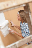 Home improvement: Woman painting wall Stock Photos