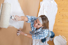 Home improvement: Woman painting wall Stock Images