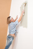 Home improvement: Woman painting wall Royalty Free Stock Image