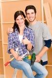 Home improvement young couple DIY repair tools. DIY home improvement young happy couple with hand drill ruler Stock Photos
