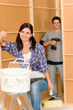 Home improvement: young couple fixing new house. Home improvement: young happy couple fixing new house renovating wall royalty free stock photos