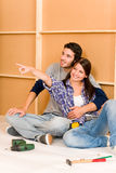 Home improvement young couple relax on floor Royalty Free Stock Photos