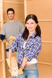 Home improvement young couple work on renovations. Home improvement young couple fixing house working on floor renovations Royalty Free Stock Image