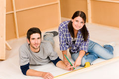 Home improvement young couple work on renovations Royalty Free Stock Photos