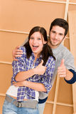 Home improvement young happy couple thumb up Royalty Free Stock Photography