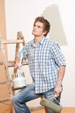Home improvement: Young man with paint roller Royalty Free Stock Photography