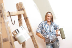 Home improvement: Young woman with paint roller Royalty Free Stock Photo