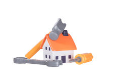 Home improvements and renovations concept. Home improvements, DIY and renovations concept with a small tool kit arranged around a model toy house isolated on stock photos