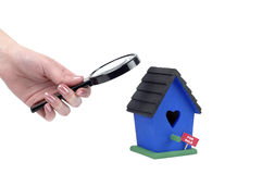 Home Inspection. Inspecting a bird house that is For Sale Royalty Free Stock Image