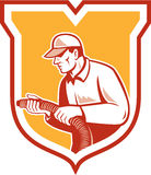 Home Insulation Technician Retro Shield. Illustration of a home insulation technician tradesman worker holding insulation pipe tubing set inside shield crest Royalty Free Stock Photography