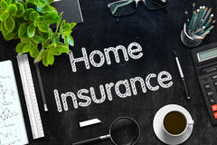 Home Insurance on Black Chalkboard. 3D Rendering. Royalty Free Stock Photo