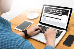 Home Insurance Claim Form Document Refund Home Insurance. Computing Computer  flare sun, Cropped image male freelancer sitting at the table Stock Images