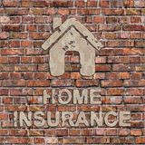 Home Insurance Concept on the Brown Brick Wall. Home Insurance Plaster Inscription with Home Icon on the Brown Brick Wall royalty free stock photo