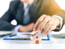 Home insurance concept with businessman. Roof open Stock Images