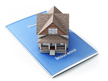Home insurance concept. House sitting on an insurance brochure with a white background Royalty Free Stock Image