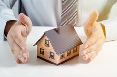 Home insurance concept. Man with house miniature. Home insurance concept. Businessman with house miniature Royalty Free Stock Photography