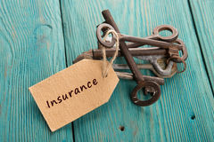 Home insurance concept. Old key with tag Stock Images