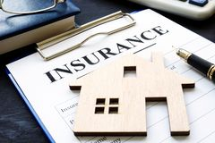 Home insurance. Policy and model of house. stock image