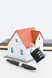 Home insurance concept. Suggested by miniature house and padlock Stock Images