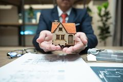 Home insurance, family life assurance protection, financial mortgage for house building, and legacy planning investment concept stock photos