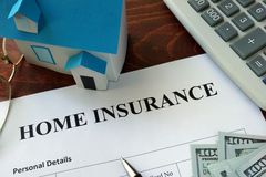 Home insurance form and dollars. Royalty Free Stock Images