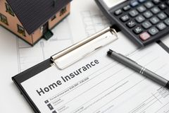 Home insurance form on the table. Assurance and home safety concept stock images