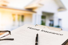 Home insurance. Insurance policy and a pen with home in background. Home insurance concepts Royalty Free Stock Photos