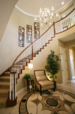 Home Interior. A staircase and entry way in a beautiful home interior