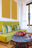 Home interior. With fruit platter on foreground Stock Images