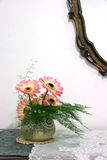 Home Interior. A small indoor flower arrangement with a mirror frame and table Royalty Free Stock Photography