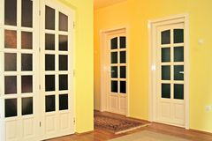 Home interior. _yellow walls and  white doors Royalty Free Stock Images